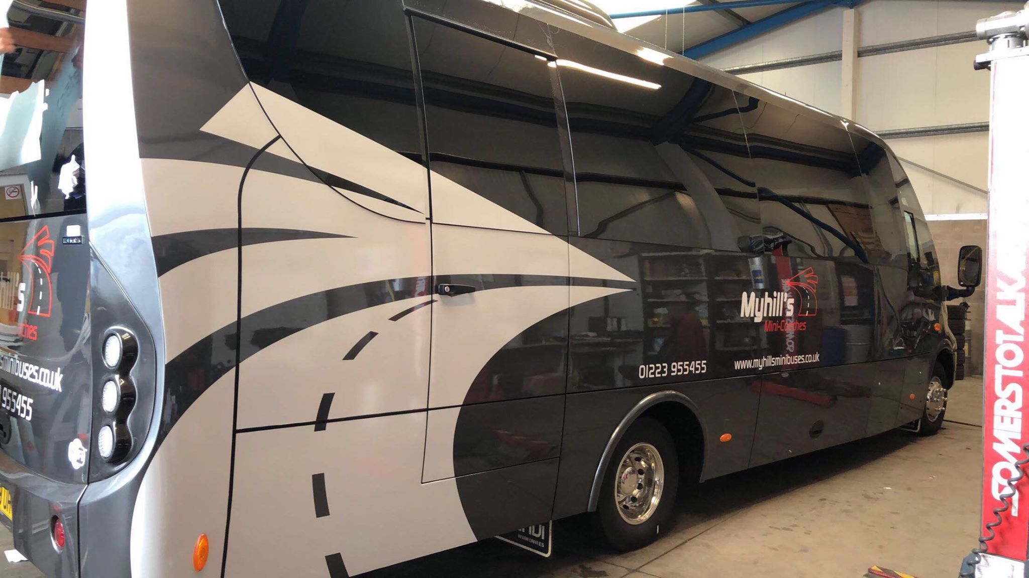 Myhills vinyl coach graphics with reflective details