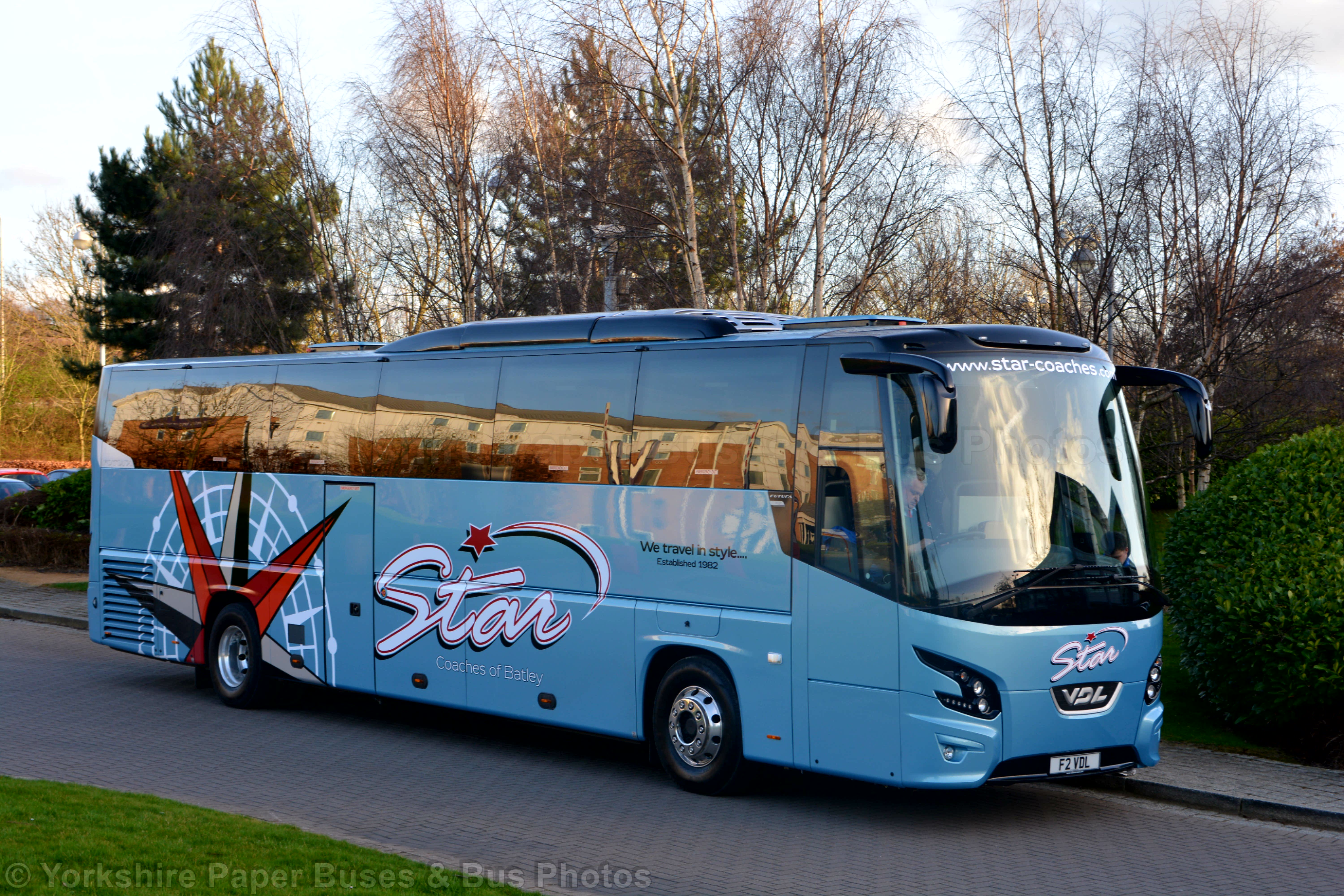 Star Coaches coach graphics with large compass in overlaid vinyl